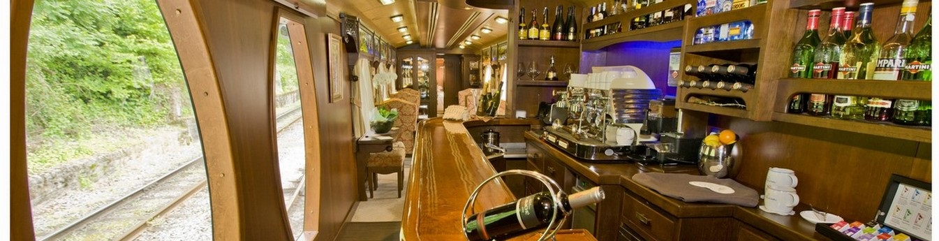 Spend time in the bar onboard while watching Spain pass by in the large windows