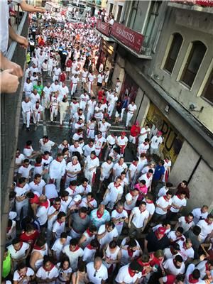 Watch participants of the bull run from the balcony