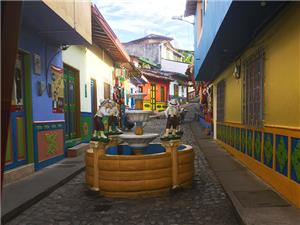 Cobblestone streets and decorated facades in Guatape
