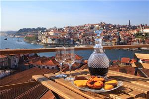 Pastel de Nata and wine with a view of Porto