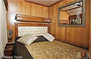 Luxury suite with double bed on board the train